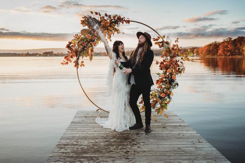Boho vibes, fall wedding, bride and groom, champagne pop, celebration